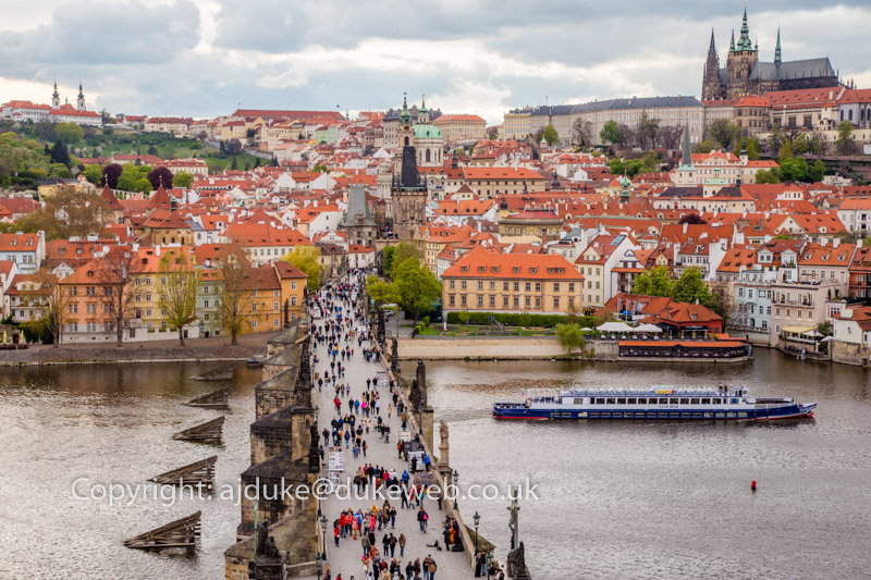 The Charles Bridge crossing the Vltava river and the St Vitus cathedral in Prague, Czech Republic