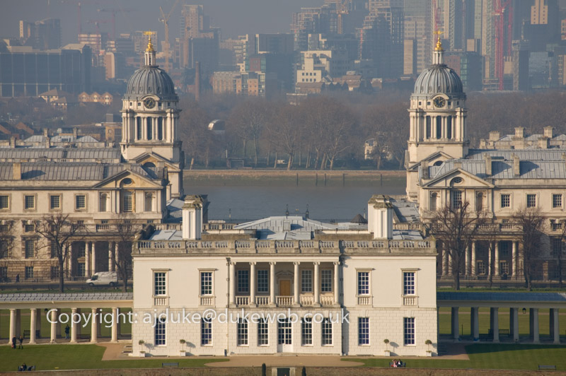 Queens house, old Royal Naval College, now part of the University of Greenwich, river Thames and docklands seen from Greenwich Park, London