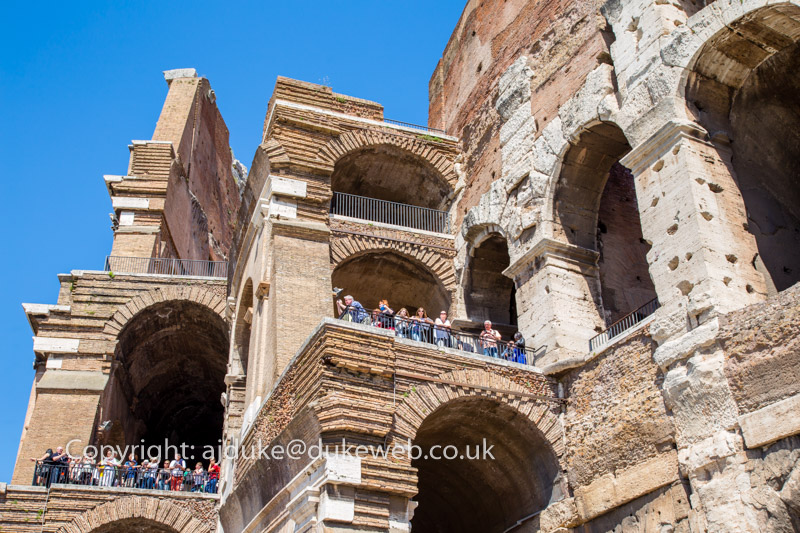 Tourists visiting the Colosseum amphitheatre in Rome